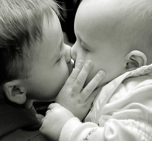 http://patcegan.files.wordpress.com/2010/12/babies-kissing.jpg?w=300&h=277