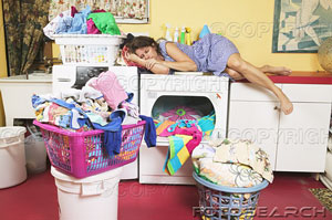 woman-napping-while-doing-laundry-bcp028-52-7978951