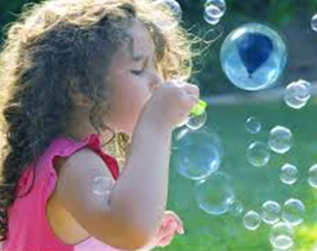 soap bubbles little girl